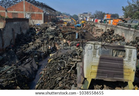 Junkyard, located in West Delhi, India, is said to be Asia's largest vehicle scrap yard. It is where all vehicles come to be processed for recyclying. #1038558655