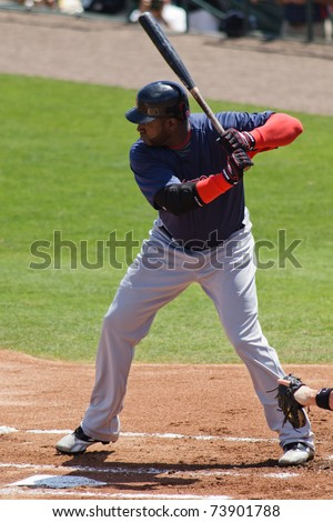 "JUPITER, FL USA - MAR. 24: Red Sox designated hitter David ""Big Papi"" Ortiz bats during the Boston Red Sox vs. Florida Marlins spring training game on March 24, 2010 in Jupiter, FL."