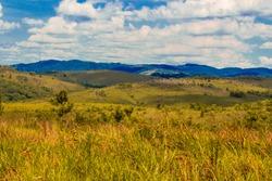 Juquery Park, located in Franco da Rocha - SP. Very green, vegetation, blue sky, with beautiful clouds and lush hills found in the Serrado da Serra da Cantareira.