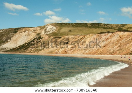 Jurassic coast beach in the summertime. A beautiful summertime beach scene along the Jurassic coast of Dorset, United Kingdom. #738916540