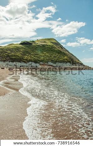 Jurassic coast beach in the summertime. A beautiful summertime beach scene along the Jurassic coast of Dorset, United Kingdom. #738916546