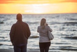 Jurmala, Latvia. Sunset at the Baltc sea. Man and woman at sunset