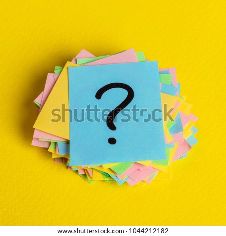 Just a lot of question marks on colored papers.