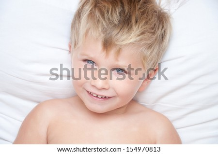 Just awaked boy. Portrait of a cute handsome child awakened