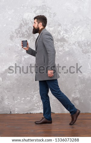 Just bought takeaway coffee. Man handsome bearded businessman hold cup of coffee. Coffee break concept. Business people fashion. Smart casual style clothes for office life. Best coffee served for him.