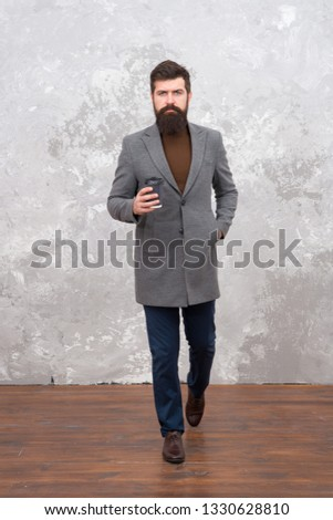 Just bought takeaway coffee. Smart casual style clothes for office life. Best coffee served for him. Man handsome bearded businessman hold cup of coffee. Coffee break concept. Business people fashion.