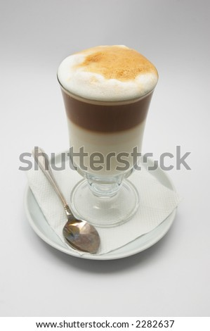 just brewed glass mug of coffee frappe with crisp foam.
