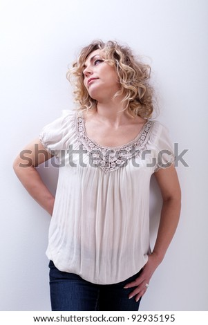 Just chilling - beautiful woman leaning against the wall
