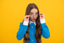 Just curious. Curious girl in eyeglasses. Nerdy-looking kid yellow background. Back to school