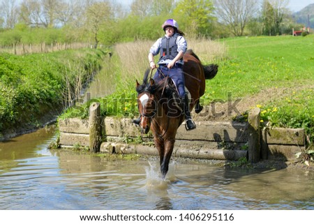Just do it- a horse jumps down into a water jump.  #1406295116