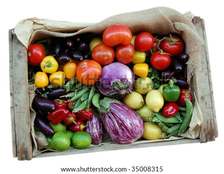 Just harvested fresh and ripe biological vegetables and fruits in a wooden box isolated over white. Clipping path.