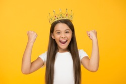 Just look at me. Princess concept. Girl princess. Lady little princess. Compelling baby. Kid wear golden crown symbol of princess. Girl cute baby wear crown yellow background. Success and happiness.