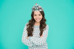 Just look at me. Princess concept. Girl princess. Lady small baby princess. Number one. Kid wear golden crown symbol of princess. Girl cute baby wear crown blue background. Success and happiness.