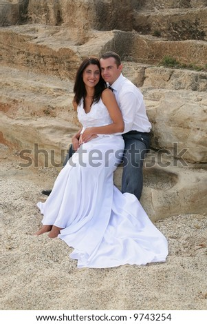 Just Married - bride in groom's arms smiling - stock photo