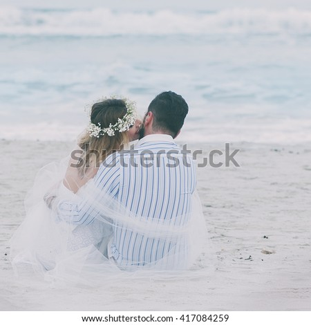 Just-married couple on the summer beach, selective focus and square image #417084259