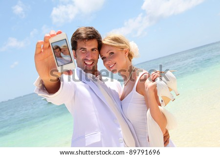 Just married couple taking picture of themselves