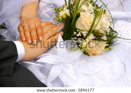 just married - hands, rings, bouquet