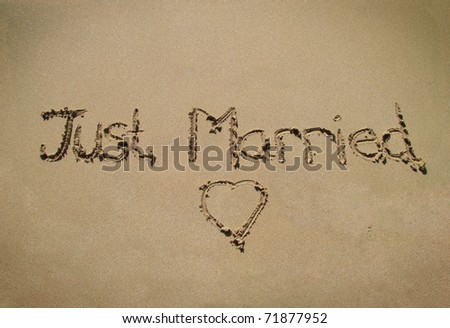 Just married message in beach sand - stock photo