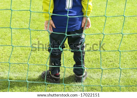 Just on the line. Young football goalkeeper with number one just on the goal line.