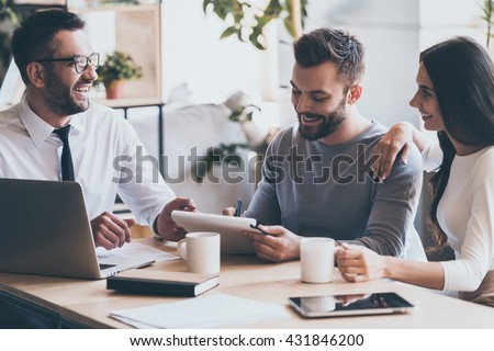 Just put your signature here! Cheerful young man signing some documents while sitting together with his wife and man in shirt and tie  #431846200