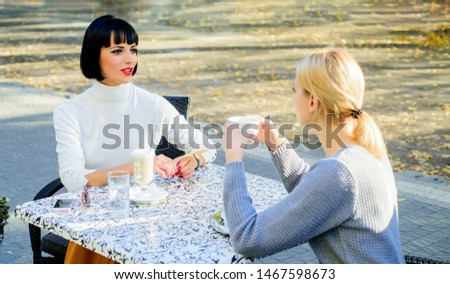 Just relaxing. bisiness lunch. summer fashion beauty. happy friends girls meet in cafe. gossip concept. happy lunch. female frienship. Relax with coffee. coffee time. free time with joy.
