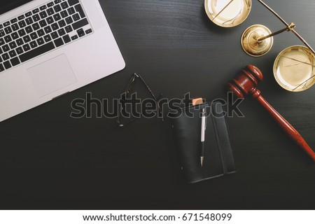 justice and law concept.Lawyer workplace with laptop and documents with dark wooden #671548099