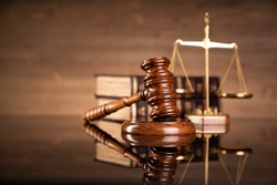 Justice legal and jurisprudence concept. Law books on lawyer desk at law firm.