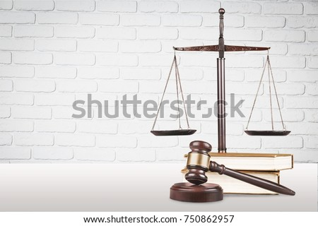 Justice Scales and books and wooden gavel on table. Justice concept