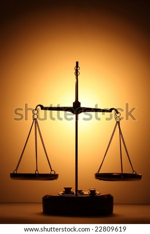 Justice scales silhouette at the back lit