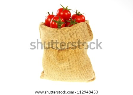 Jute bag fill of tomatoes with white background
