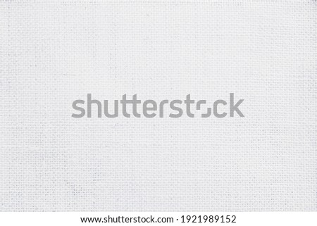 Jute hessian sackcloth canvas woven texture pattern background in light white color blank empty. Stockfoto ©