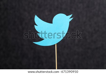 JYVASKYLA, FINLAND - JULY 2, 2017: Twitter logo cut from cardboard on wooden stick against dark background. Twitter is a social media network that was founded in 2006. Illustrative editorial.
