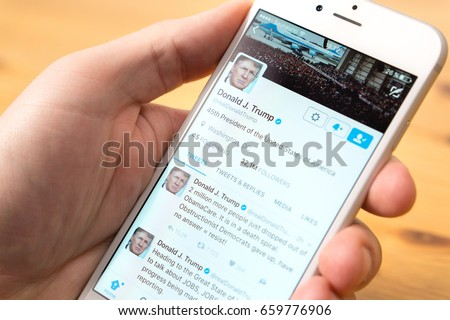 JYVASKYLA, FINLAND - JUNE 13, 2017: Phone in hand with the official Twitter account of Donald Trump on screen. The American President has over 32 million followers on Twitter. Illustrative editorial.