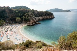 Kaş Antalya large pebble beach panoramic views sea turquoise nature beach wonderful perspective angles Tourism travel travel vacation buying now.