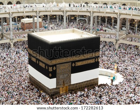 Kaaba the Holy mosque in Mecca with Muslim people pilgrims of Hajj praying in crowd newest and very rare images of Holiest mosque after latest widening 2013-3014