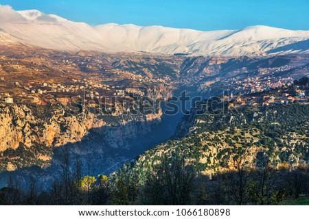 Kadisha Valley. UNESCO World Heritage Site.  Bsharri, Lebanon. Beautiful mountains at sunset #1066180898