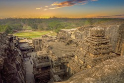 Kailas temple in Ellora caves complex carved into the rock. in India at sunset