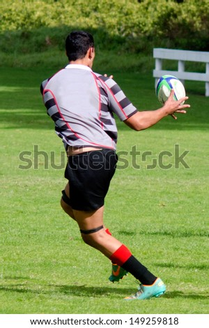 KAITAIA, NZ - AUG 03:Man plays Rugby on Aug 03 2013.Rugby union is the unofficial national sport of NZ. The national team, the All Blacks, rank as the top international team in the world.