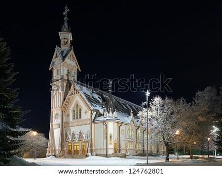 Kajaani wooden church in Gothic Revival style in winter night, Finland