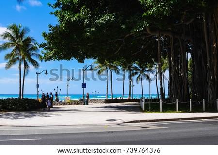 Kalakaua Avenue along Waikiki beach in Honolulu, Hawaii. Waikiki beach is neighborhood of Honolulu, best known for white sand and surfing.