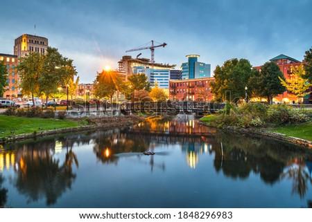 Kalamazoo, Michigan, USA downtown cityscape  and park at dusk.