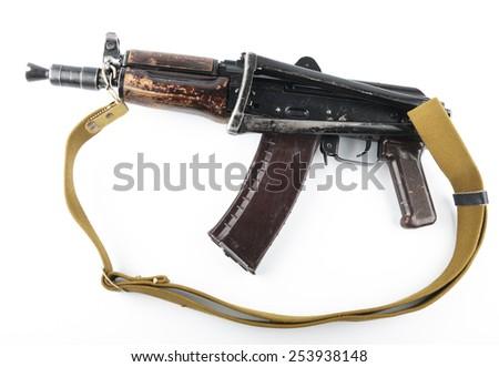 Kalashnikov rifle on bright background.