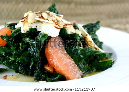 Kale salad with shaved toasted almonds.