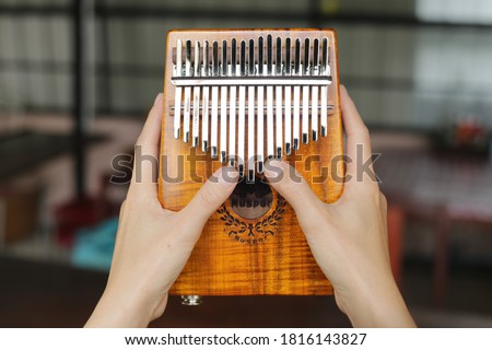 Photo of  Kalimba or mbira is an African musical instrument.Traditional to the Shona people of Zimbabwe. Kalimba made from  wooden board with metal, play on  hands and plucking the tines with the thumbs.