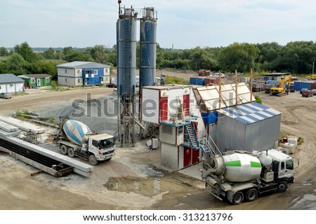 KALININGRAD, RUSSIA - AUGUST 24, 2015: Ready-mix trucks mixers stand on loading in the territory of concrete knot