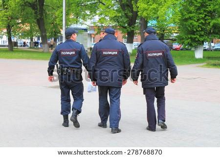 KALININGRAD, RUSSIA - MAY 8, 2014: Three policemen, seen from behind, in Kaliningrad