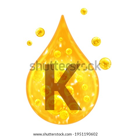 Kalium. Mineral Vitamin complex.  Mineral K. Potassium. Golden drop and golden balls Isolated on white background. Health concept. K Potassium.  Stock fotó ©