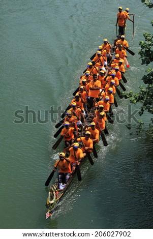 KALLADA, INDIA - SEPT 26: A snake boat team participate in the Kallada Boat race on September 26, 2012 in Kallada, Kerala, India. Boat races are the major sporting event in Kerala during Onam season.