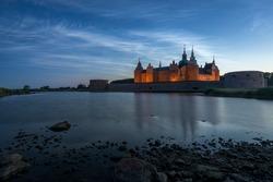 Kalmar Castle in Sweden at sunset with a moonlit summer sky