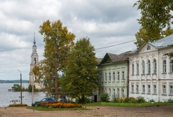 Kalyazin Bell Tower (Flooded Belfry over waters of Uglich Reservoir on Volga River) as part of Monastery of St. Nicholas, opposite old street of Kalyazin, Tver region, Russia